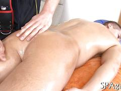 Sexy guy gets his ass spread and oiled up during massage