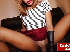 Busty ladyboy jerksoff cock with handgloves
