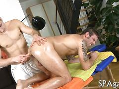 Oiled up hot guy gets bareback fucked by a masseur