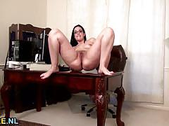 Brunette milf plays with her hot pussy