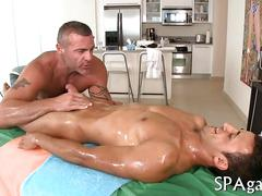 Mature masseur with strong body seduces nude oiled up straight guy