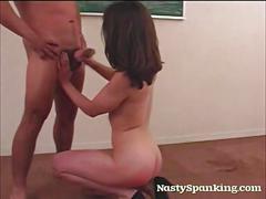 Spanked girl gives a good handjob