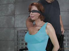 Blindfolded milf offering sexual favors