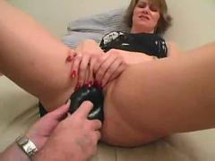Amateur boyfriend helps girlfriend masturbate with a huge dildo