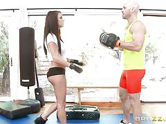 Big tit brunette getting naughty with the trainer