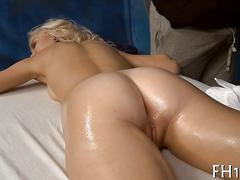 Shaved blondie with beautiful body gets fucked in massage parlor