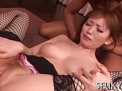 Japanese stunner in fishnet stockings fucked apart in a threeway