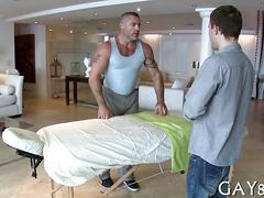 Tattooed stud bangs a guys ass during an oil massage