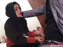 Arab lady with hijab gives head to a guy with a huge cock