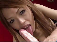 Asian brunette slobbers over this hard cock