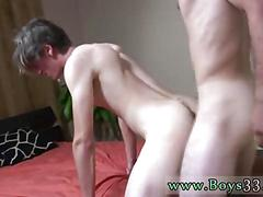 Hairy guy wanks his cock while getting ass fucked standing