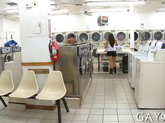 Black guy sucking on a white dick in a laundromat in public
