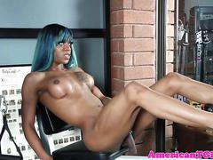 Inked black t-girl pees after masturbation
