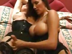 Hot busty milf fucks an old tranny with a strap-on