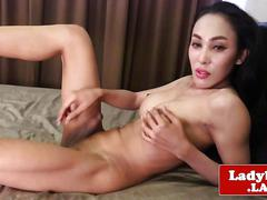 Busty bikini tgirl jerking her hard cock