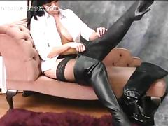 Hot busty babe loves teasing while you watch her putting on long sexy leather boots