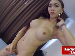 Bigtitted bikini ladyboy jerking her cock
