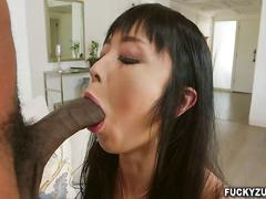 Asian babe plays with huge black ball sack and sucks cock
