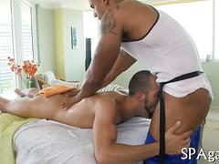 Bearded white guy gets ass fucked by black masseur oiled up