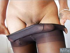 Kinky shemale in pantyhose masturbates her hard dick