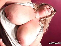 Busty mature hoe teasing her fat wet pussy