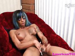 Ebony tgirl lactates while jerking off