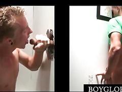 Slim blonde gay sucks dick on knees on gloryhole