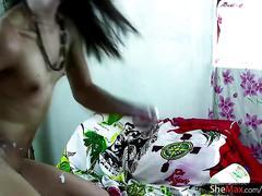Feminine asian tranny lubes her asshole and inserts eggplant
