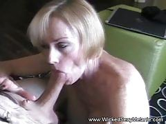 Gilf swinger blowing a cock