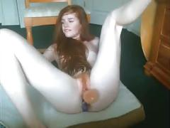 Redhead gives very sexy dildoshow