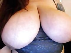 Tattooed bbw milf shows huge tempting tits off solo