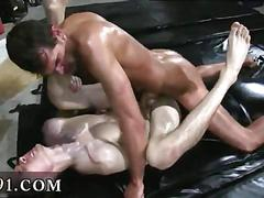 Oiled up college boys fuck and cum in garage during hazing