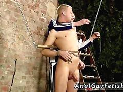 Blond twink gets covered in wax and jerked off in bondage