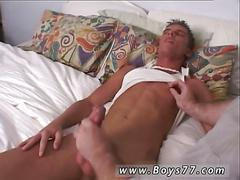 Fat old guy rubs a horny twinks hard cock in bed