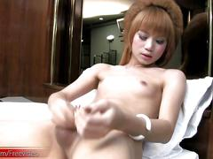 Ultra feminine redhead ladyboy is teasing and jerking cock