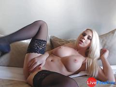 Young blonde with big tits and stockings