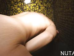 Busty honey fingering her pussy in the shower solo