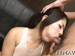 Japanese beauty sucking off two massive dicks in threesome