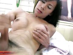 Feisty thai t-girl strips down and jacks dick for the camera