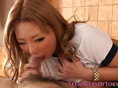 Asian teen wraps her lips round this hard cock