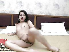 Ladyboy with natural puffy nipples strokes cock in closeup