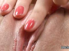Lovable sweetie is gaping wet slit in closeup and cumming