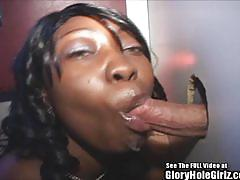 Ebony amateur sucking cock at gloryhole