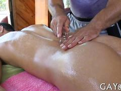 Oiled up guy gets fucked by his mature hairy masseur