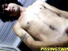 Long hair twink jerking his hard cock standing up naked