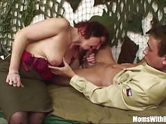 Senior army officer reprimands a soldier by sucking his cock