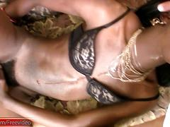 Dark skinned black t-girl eats cock and gets ass fingered