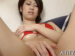 Busty japanese chick gives a tit fucking on her couch