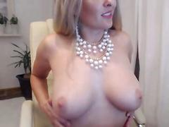 Sexy mature blonde with dildo in pussy spreads cream
