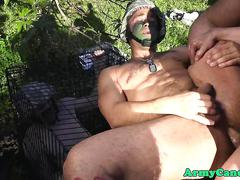 Uniformed soldier fucked outdoors on a cage